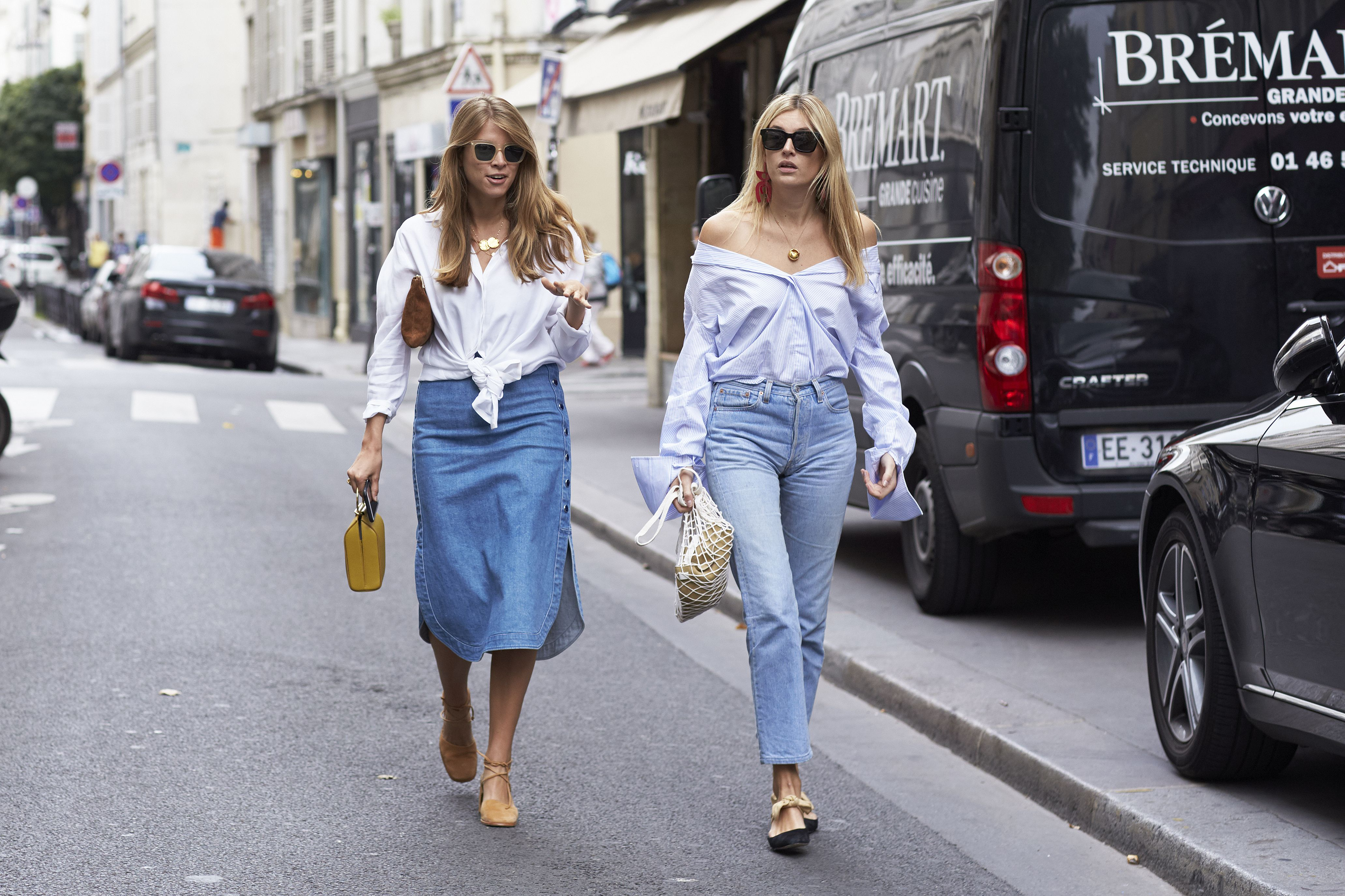 Street style stars Monica Ainley and Camille Charriere wearing sexy summer tops at Paris Fashion Week.